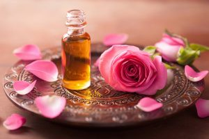 Rose and rose oil on a tray